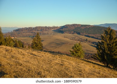 Hill Javor with farm under it bathed in morning sunlight, Slovakia - Shutterstock ID 1889590579