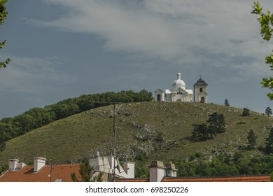 Hill in Mikulov town with church in summer day