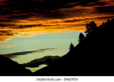 Hill with orange sky
