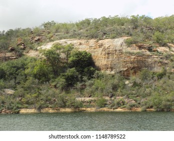 Hill slope with vegetation at the river's edge