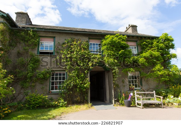 HILL TOP HOUSE, NEAR SAWREY, LAKE DISTRICT, ENGLAND-JULY 8 2014: Sunny summer weather on Tuesday 8th July 2014 brought visitors to Hill Top House Near Sawrey former home to Beatrix Potter