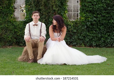 Hillbilly hipster vintage style bride and groom outside church after wedding ceremony