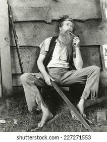 Hillbilly smokes clay pipe