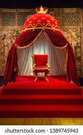 Hillerod, Denmark - June, 2016: Throne Hall of Frederiksborg Castle. The royal throne in the interior of the Frederiksborg Castle.