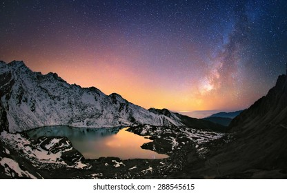 Hills around Gosaikunda lake (4,438 m) in Himalayas and the Milky Way galaxy above this sacred place. Nepal, Langtang region.
