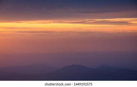 Hills of Beskydy Mountains with Sunset Clouds