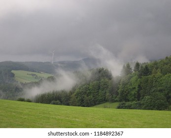 The hills of Black Forest/Schwarzwald, Germany with dark sky and  clowds in bad rainy weather