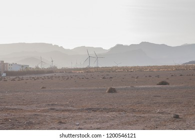 Hills with haze and windturbines.