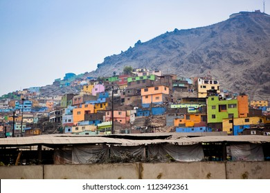 in the hills of Lima, Peru are houses thrown up and painted with bright colors.