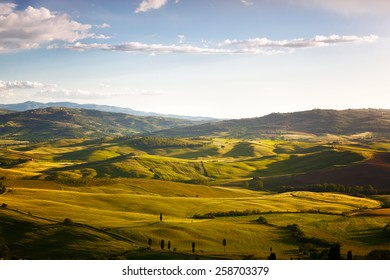 hills lit with the morning sun, a rural landscape in Tuscany, Italy
