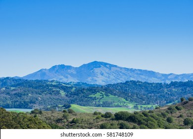 Hills and meadows in Wildcat Canyon Regional Park; San Pablo Reservoir; Mount Diablo in the background, east San Francisco bay, Contra Costa county, California