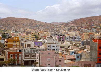 Hills of Mindelo crowded with colorful homes under blue skies