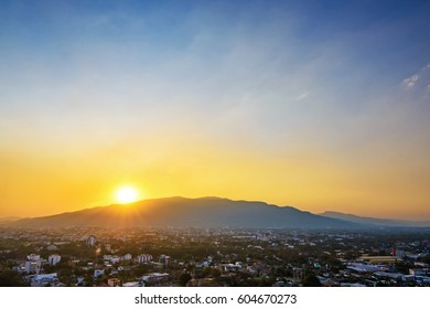 Hills and orange sky with clouds during sundown, sunset in Chiang Mai, Thailand. Composition of the nature