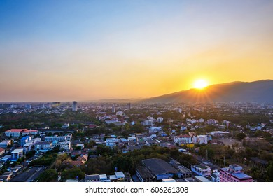 Hills and orange sky with clouds during sundown, sunset in Chiang Mai, Thailand. Composition of the nature, On March 18, 2017 in Chiang Mai.