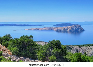 Hills overlook the islands and deep blue water of the Adriatic sea near Senj, Croati