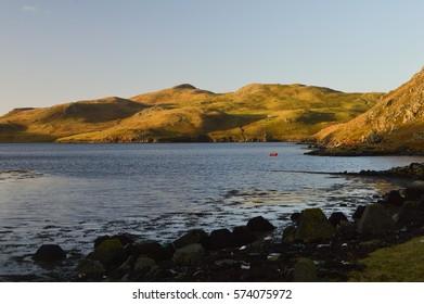 Hills and sea loch in Mavis Grind on Shetland Islands