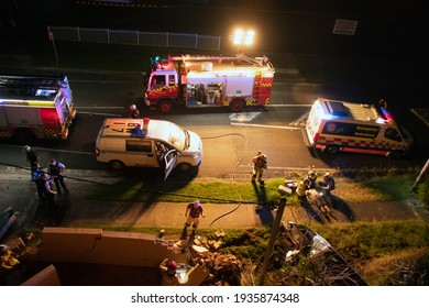 Hills St, Gosford, NSW, Australia. 1 am-March 13, 2021, Car smashes into the front brick wall of a block of home units and is attended by Fire, Ambulance and Police services. Part of a series,