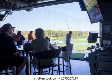Hillsboro, Oregon - May 11, 2019 : View of TopGolf in Oregon, Entertainment venue with swanky lounge with drinks & games