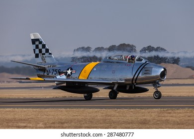 HILLSBORO, OR - SEPT 21: North American F-86F Sabre demonstration during Oregon International Air Show at Hillsboro Airport on September 21, 2014 in Hillsboro, OR.