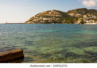 Hillside houses overlooking the Mediterranean Sea as seen from across the bay at Port d'Andratx in Mallorca, Spain.