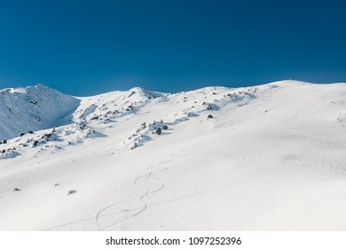 Hillside with ski tracks in Mammoth Lakes, California, January 2017, a record snow-fall year