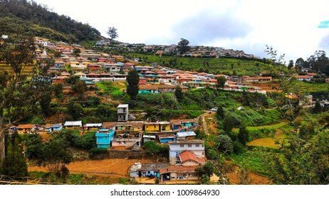 A hillside slope with settlements on the hills of Ooty, India