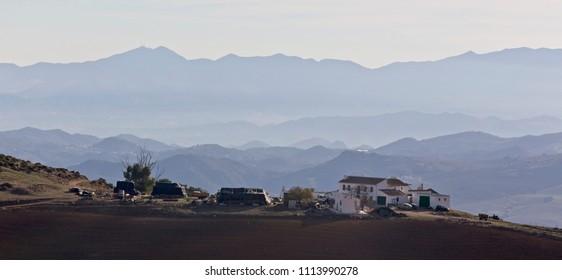 A hilltop farmstead in the Montes de Malaga, Andalucia, Spain.