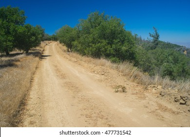 Hilltop road leads into the wilderness of southern California near Santa Clarita and San Fernando valley.