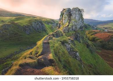 The hilltop tourist attraction Castle Ewan at the Fairy Glen in golden sunset or sunrise light on the Isle of Skye, Scotland. - Shutterstock ID 1955758318