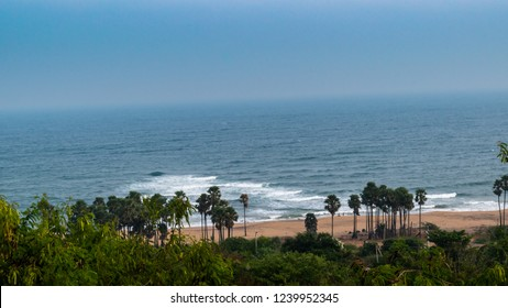 Hilltop view of Beach with Palm trees at Vizag/ Visakhapatnam,India.