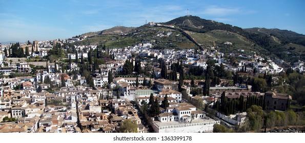 Hilltop view of Granada Spain against a summer blue sky