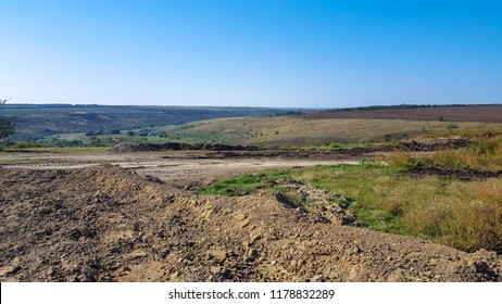 Hilly area for construction. Uncultivated land.