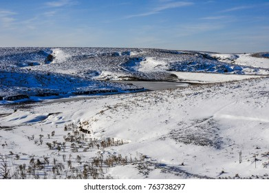 Hilly pasture with snow