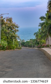 Hilly road with the view Beach with Palm trees at Vizag/Visakhapatnam,India.