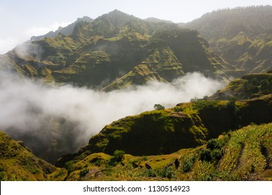 Hilly rural landscape in clouds. Village house and farmlands. Santo Antao, Cape Verde