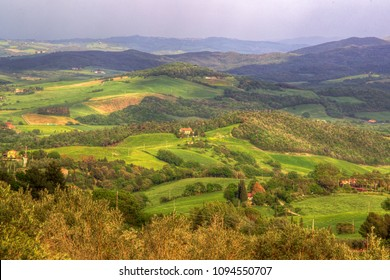 hilly Rural mountain landscape in the Italian Tuscany near the city of Volterra with fields and single lonely houses or small villages