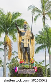 HILO, HAWAII - SEPTEMBER 4, 2014: A statue of the legendary warrior king Kamehameha the Great wearing a golden robe stands proudly in Hilo, Hawaii.