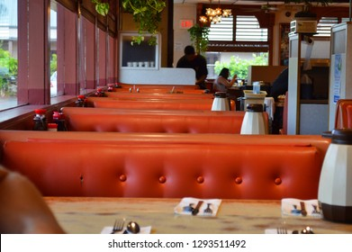 Hilo. Hawaii USA July 23 : Inside a traditional American diner with 1970s decor design orange seats and booths. taken in ken's diner in hilo hawaii on a quiet morning for breakfast