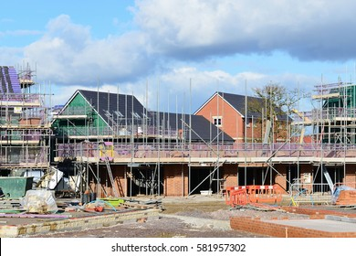 Hilperton, UK - February 21, 2015: View of a new building site. The Wiltshire village near Trowbridge is part of the UK's construction boom with the number of new homes being built up 10% since 2013.