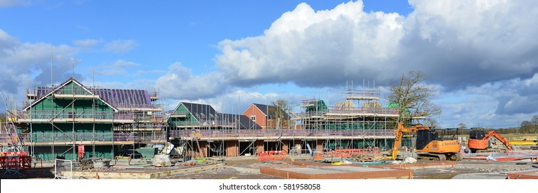 Hilperton, UK - February 21, 2015: Panoramic view of a building site. The Wiltshire village is part of the UK's construction boom with the number of new homes being built up 10% since 2013.