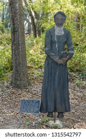 Hilton Head Island, SC - April 12, 2018: This metal figure of Harriet Tubman by Mary Ann Browning Ford and accompanying sign at Fort Howell tells of her time at Hilton Head Island.