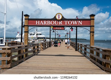 HILTON HEAD ISLAND, SC/U.S.A. - AUGUST 1, 2018: A photo of the Harbor Town sign and pier.  Harbour Town is located inside the Sea Pines Resort and features a variety of shops.