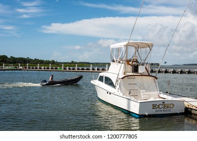 "HILTON HEAD ISLAND, SC/U.S.A. - AUGUST 1, 2018: A photo of the ""Echo"" speedboat, docked at the Sea Pines Harbour Town marina, an exclusive resort enclave."