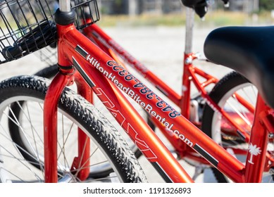 HILTON HEAD ISLAND, S.C./U.S.A. - JULY 31, 2018: A photo of red bicycles for rent in the community of Coligny Beach Park.