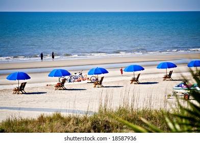 Hilton Head Island, South Carolina beach landscape - rental umbrellas, bikes and chairs.