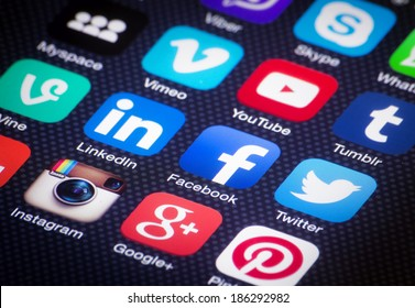 HILVERSUM, NETHERLANDS - APRIL 03, 2014: Social media are trending and both business as consumer are using it for information sharing and networking. Showing social media icons on smartphone.
