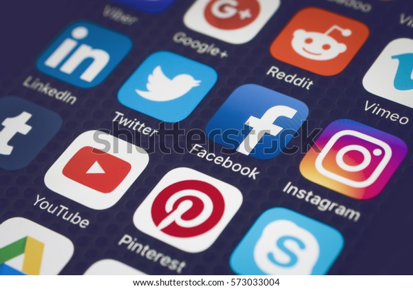 HILVERSUM, NETHERLANDS - FEBRUARI 06, 2017: Social media are trending and both business as consumer are using it for information sharing and networking. Showing social media icons on smartphone.