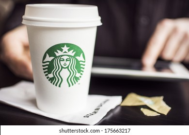 HILVERSUM, NETHERLANDS - FEBRUARY 06, 2014: Starbucks Corporation is an American global coffee company and coffeehouse chain based in Seattle, Washington founded in 1971 with stores in 62 countries.