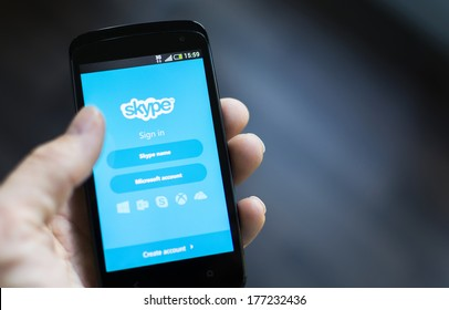"HILVERSUM, NETHERLANDS - FEBRUARY 14, 2014: Skype is a voice-over-IP service and instant messaging client, developed by the Microsoft Skype Division. The name was derived from ""sky"" and ""peer"""
