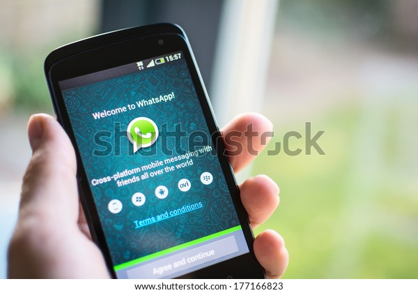 HILVERSUM, NETHERLANDS - FEBRUARY 2014, 2014: WhatsApp Messenger is a proprietary, cross-platform instant messaging subscription service for smartphones with Internet access founded in 2009.